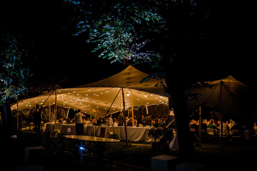 Garden lights on wedding under a tent in Tuscany